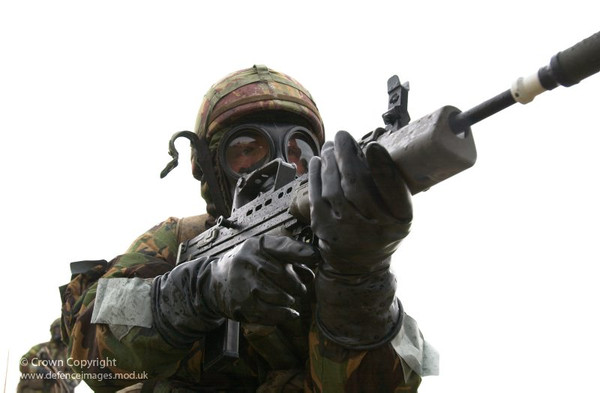 Soldier wearing butyl chemical protection gloves