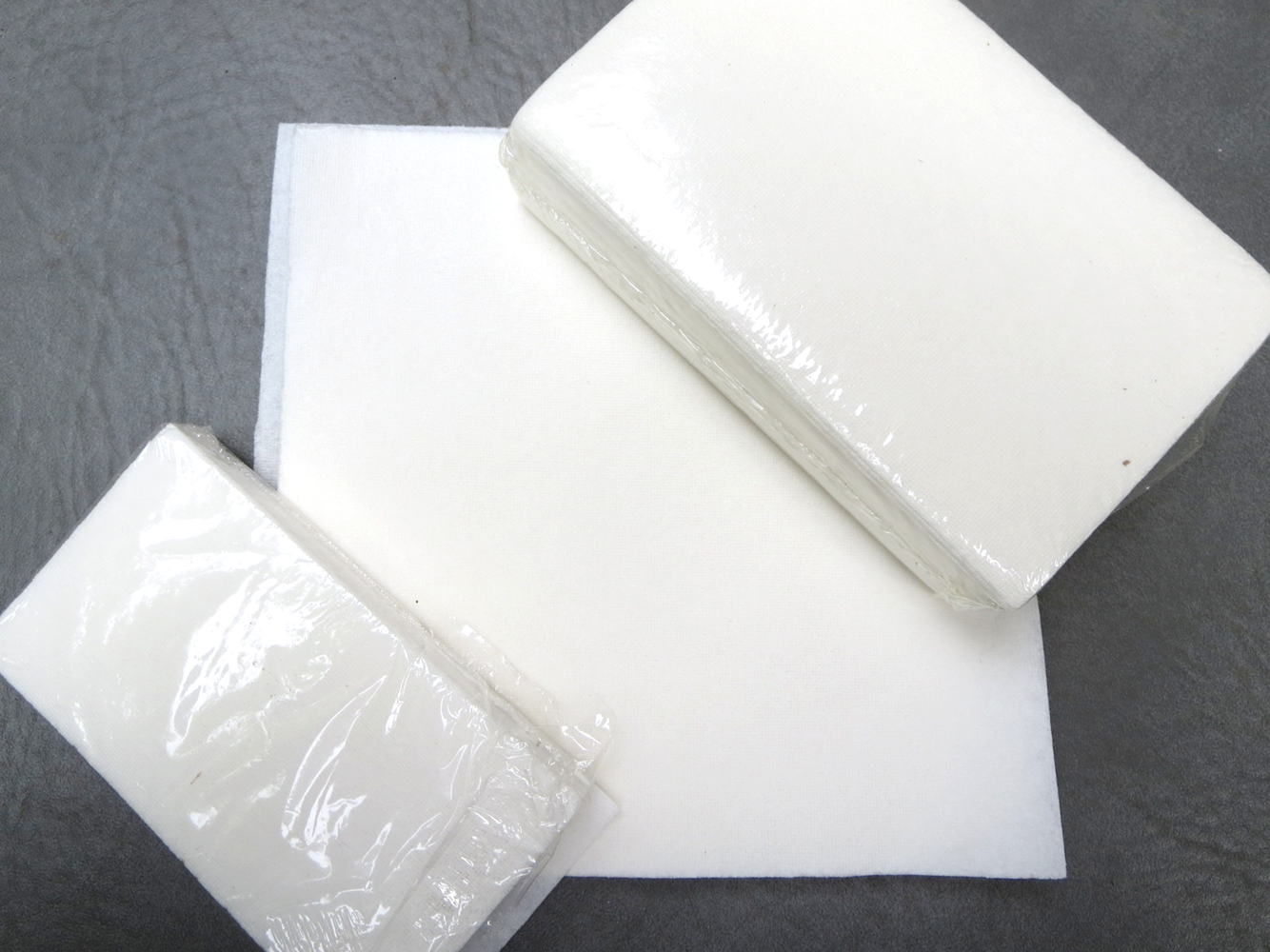 #02-01282CG13 DriMop® Absorber/Solidifier 4-1/4` x 2-1/4` Laminated Paper Sheets