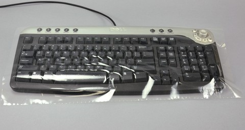 Disposable Clear Keyboard Protective Covers w/ Adhesive Backing 9` X 19`. Perforated roll.